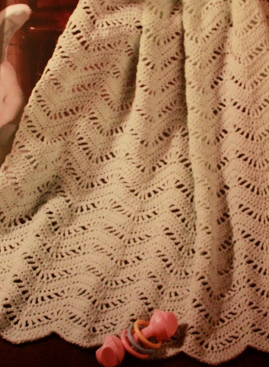 Gentle rolling waves of mint green make this afghan a good choice for boys or girls.  Treble crochet stitches and chain spaces form the lacy openwork between solid ripples of half double crochets. Use Code # 213 Price $100.00