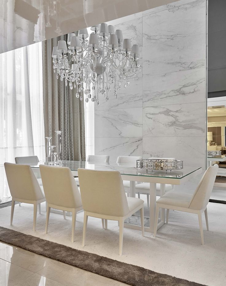 Luxury dining room marble walls and statement chandelier are beautiful for Wall art for dining room area