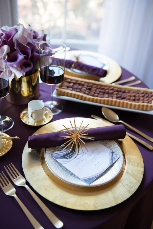 Thanksgiving table setting in purple and gold