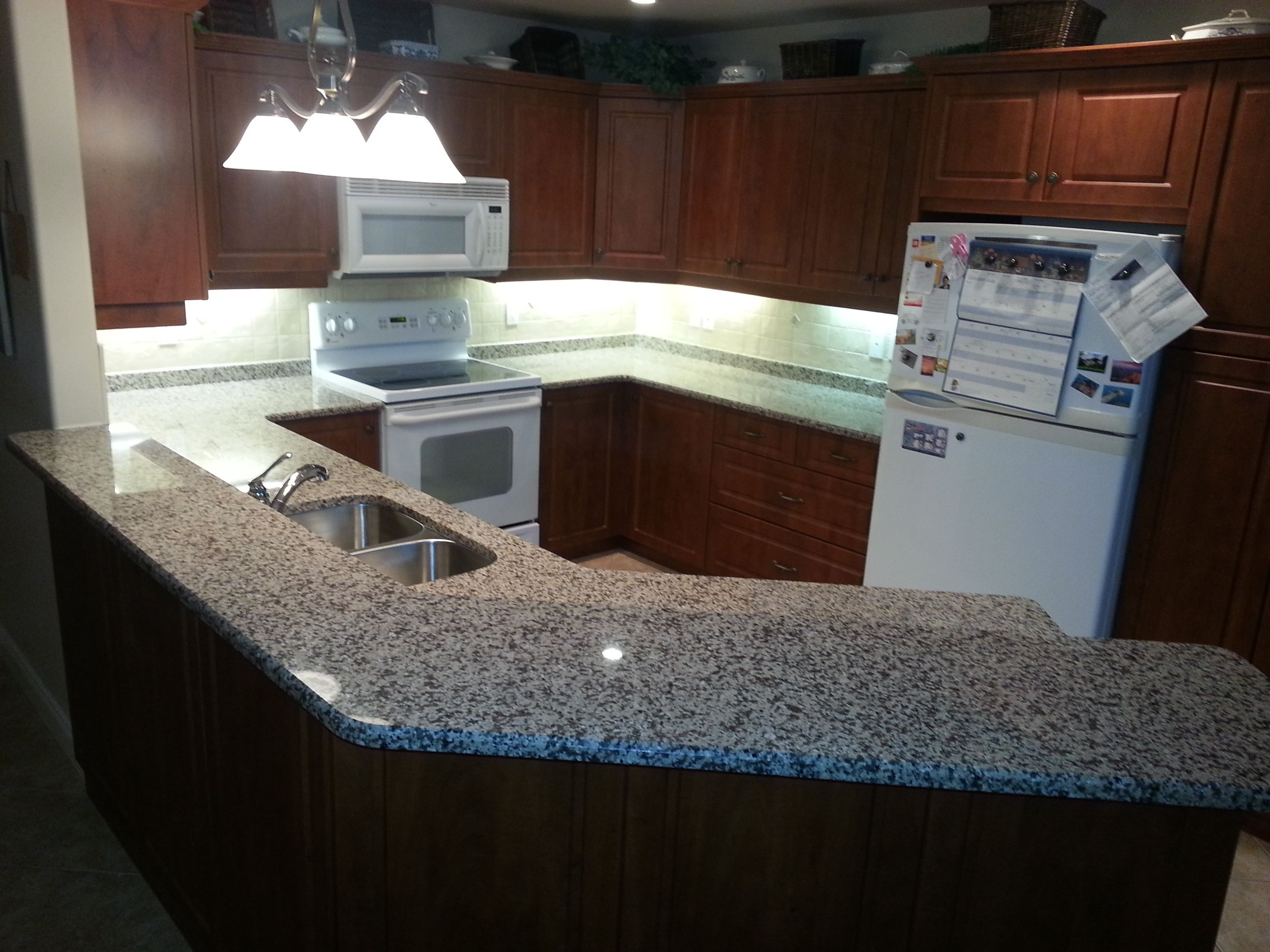 Bianco Sardo Granite Countertops With Raised Bar