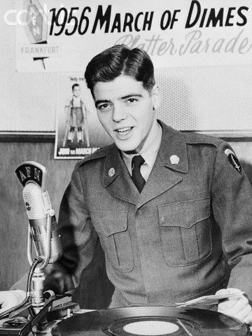 "Supporting the U.S. Army northern area command's March of Dimes is Private Nick Clooney, brother of singer Rosemary Clooney. He is a disc jockey for the Armed Forces network ""Platter Parade,"" broadcast yearly in support of the campaign to raise funds for the fight against infantile paralysis. January 17, 1956"