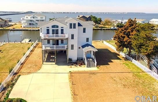 Spacious and contemporary 4 bedroom home on the canal in Nags Head. MLS# 91470.