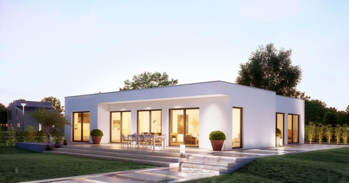 Massivhaus kern haus bungalow purea gartenseite am abend for Massivhaus modern