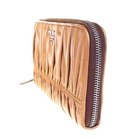 7f3ee6aadfed Authentic Vintage Prada WalletGreat conditionFree. Find this Pin and more  on Women's Wallets ...