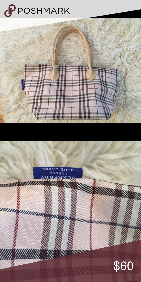 930a5c5cf32 Pretty in Pink Burberry Tote Good condition Burberry tote. Blue Label tag.  Pretty in pink with with classic check print. So close to the real deal!