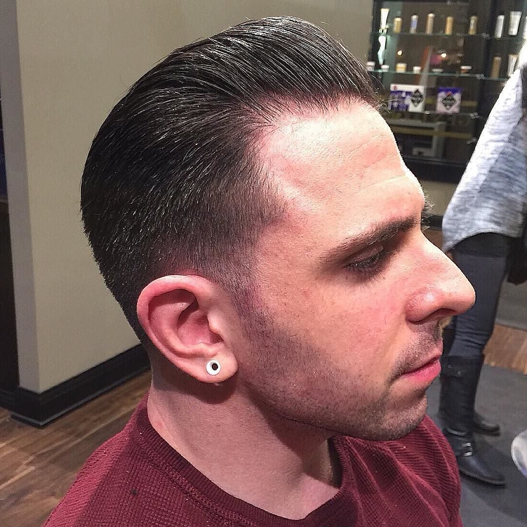slick back low taper fade. styled with suavecito original pomade