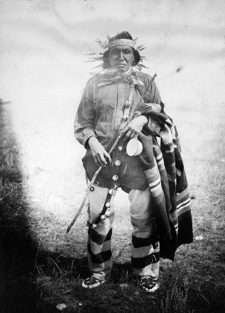 Turning Bear, a Native American (Yanktonai Sioux) man poses outdoors. - 1910/1920