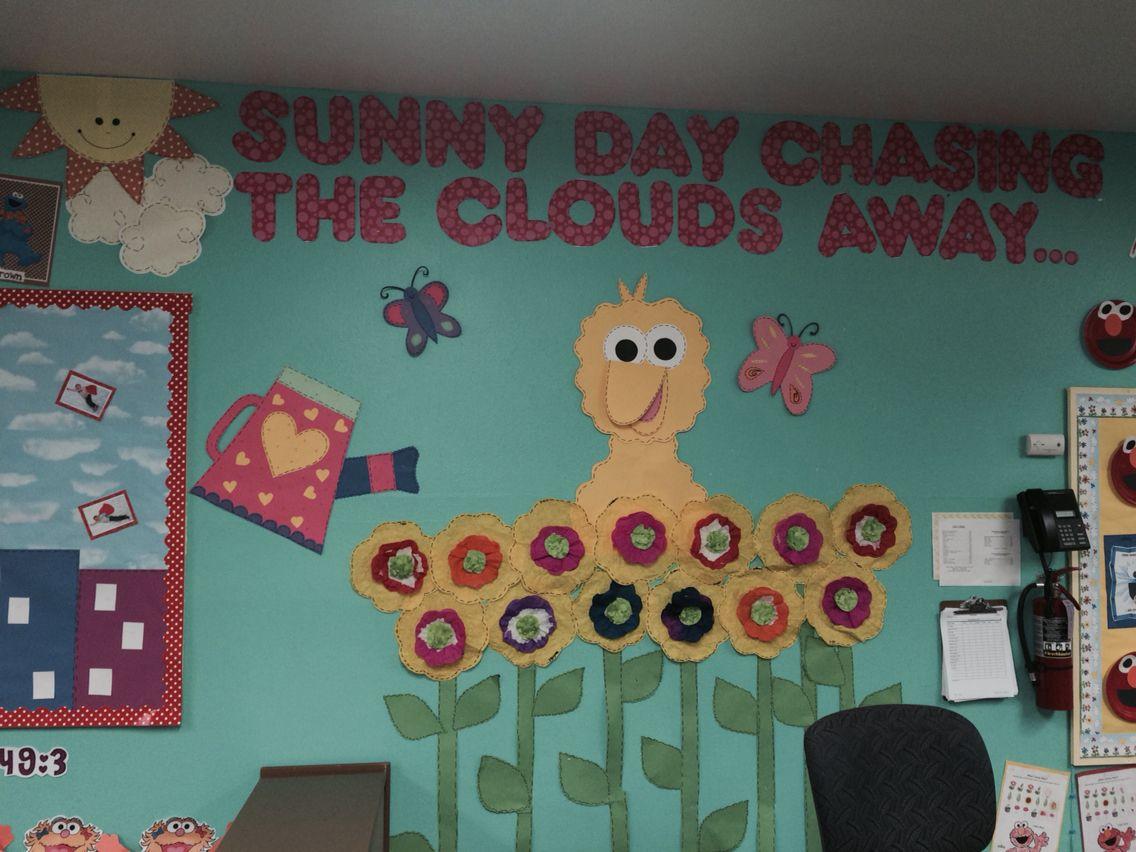 Sesame Street Theme Classroom Sunny Day Chasing The Clouds Away Each Child Made A Flower Ou Sesame Street Crafts Classroom Themes Preschool Classroom Decor