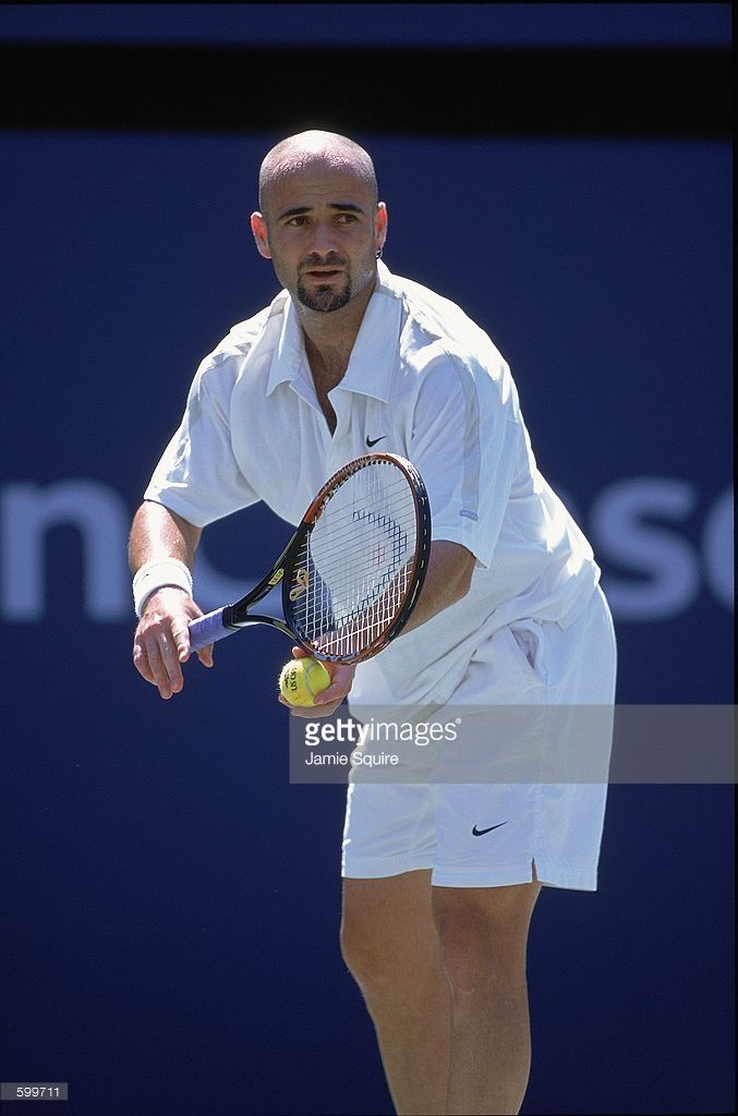 298a41f18c5b Andre Agassi of the USA gets ready to serve during the match against ...