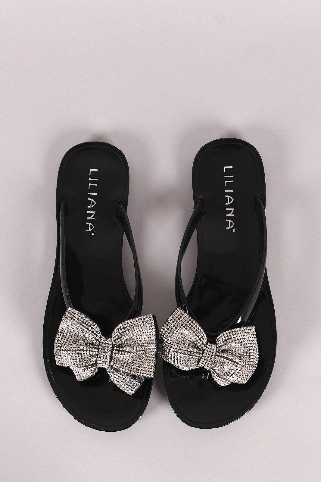 778e2e1485bd95 These chic thong sandal feature a bow decor on V-shape strap