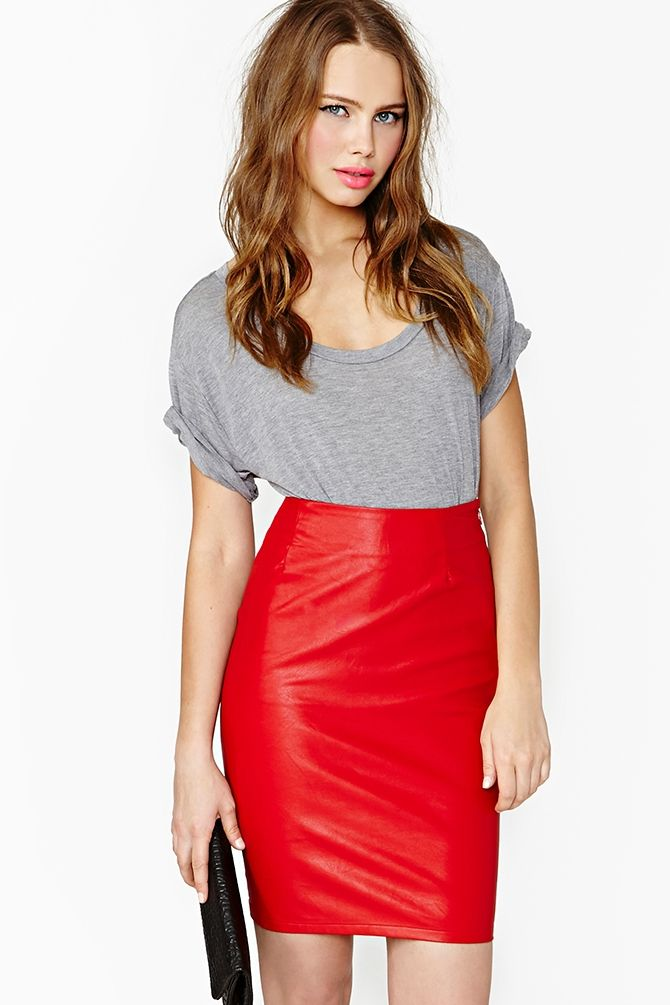 Hot To Trot Skirt: Hit the town in this red hot vegan leather pencil skirt featuring a high waist with seamed detailing. Hook/eye and zip closure at side, stretch fabric. Unlined. Looks killer with a sleek bustier or tied-up vintage tee!