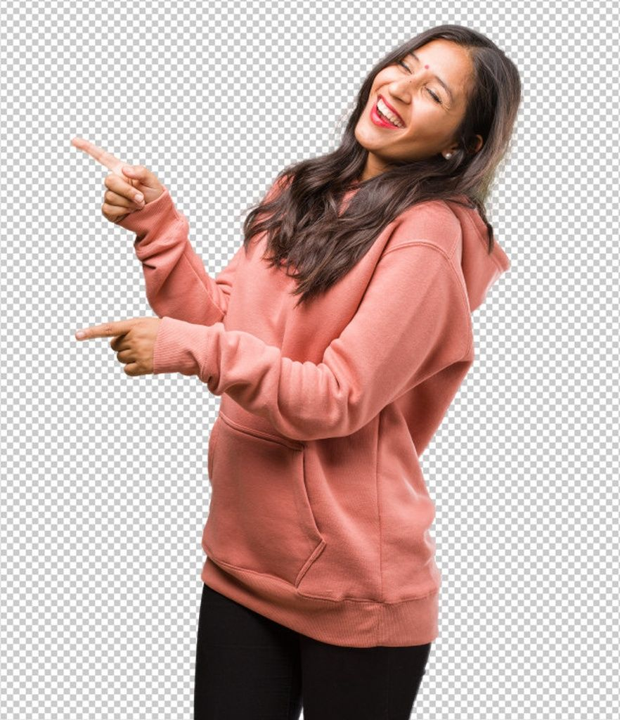 Portrait of fitness young indian woman pointing to the side, smiling surprised presenting something,...