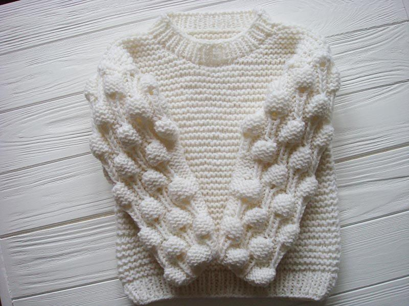 5241f45c2 Oversized Bobble Sweater | This adorable knit baby sweater features the  always interesting bobble stitch on the sleeves.