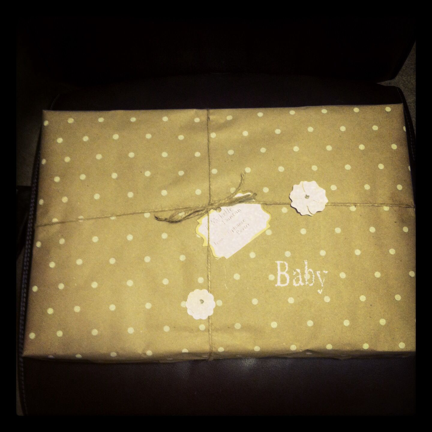 Butcher paper, garden twine, place card, and scrapbook stickers. Holiday wrapping paper.