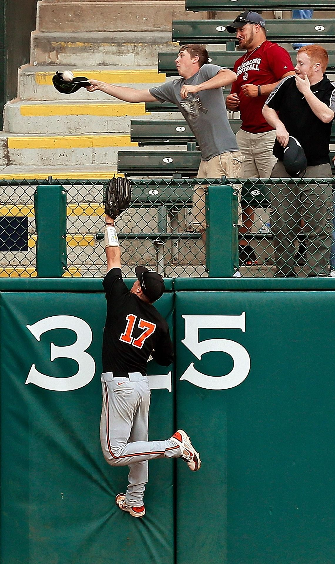 hat trick a fan uses his cap to catch a home run ball by west rh pinterest co uk