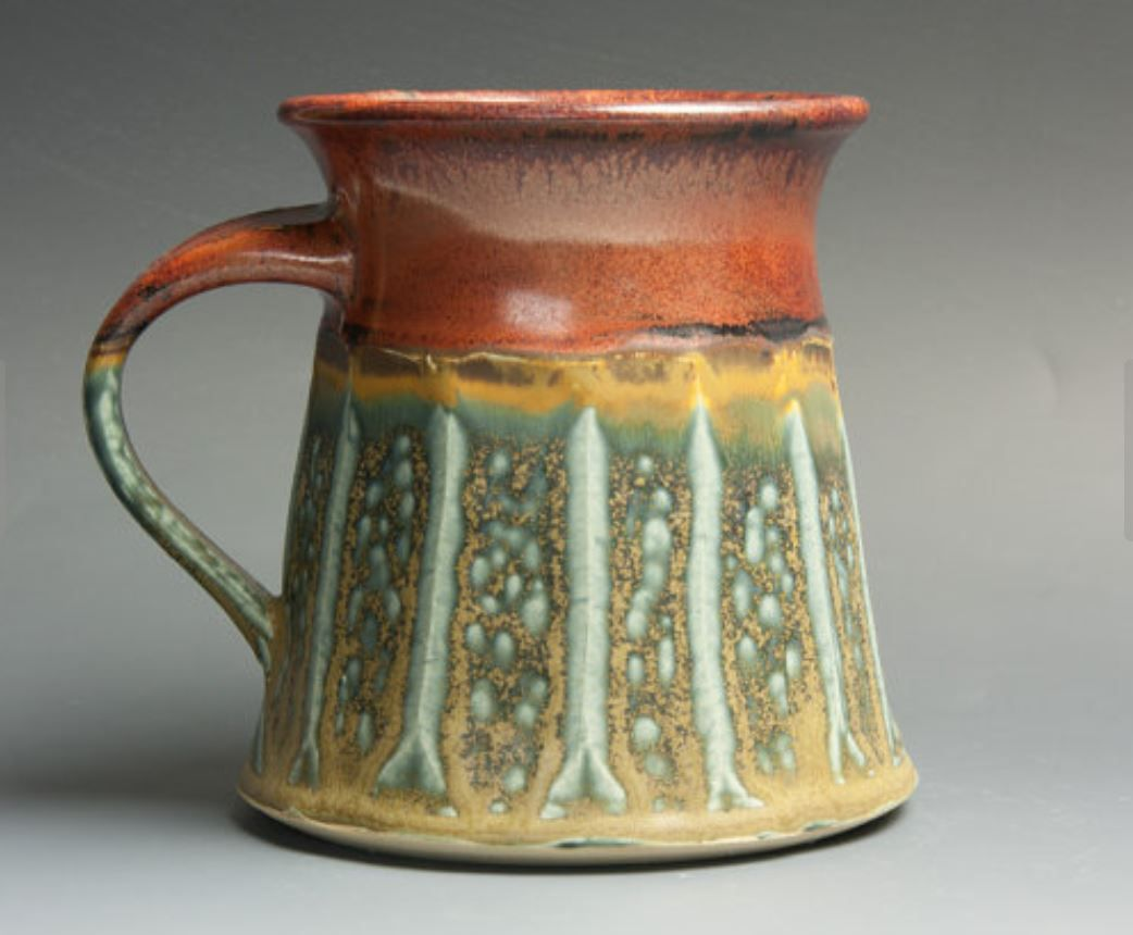 Mug from Blue Parrot Pots Stoneware, brick red liner and accents, green blue ash like glaze. 1924