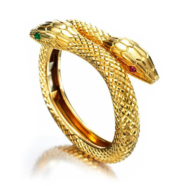 An Emerald, Ruby and Gold Snake Bracelet, by Cartier, circa 1950