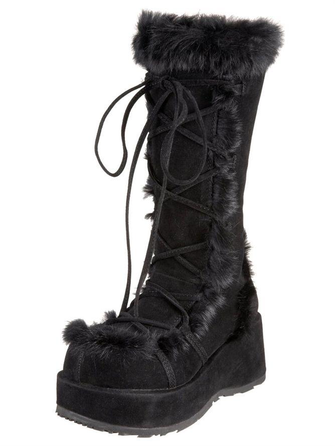 7b0de0673a7 A pair of Demonia black cubby gogo boots with fur trim.
