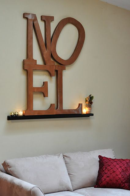 Awesome DIY with letters from craft store, glue and hammered bronze spray paint.  :) Pottery barn inspired.