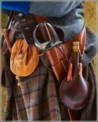 Necessities of a Highlander, sporran, sword, wine flask, and kilt.