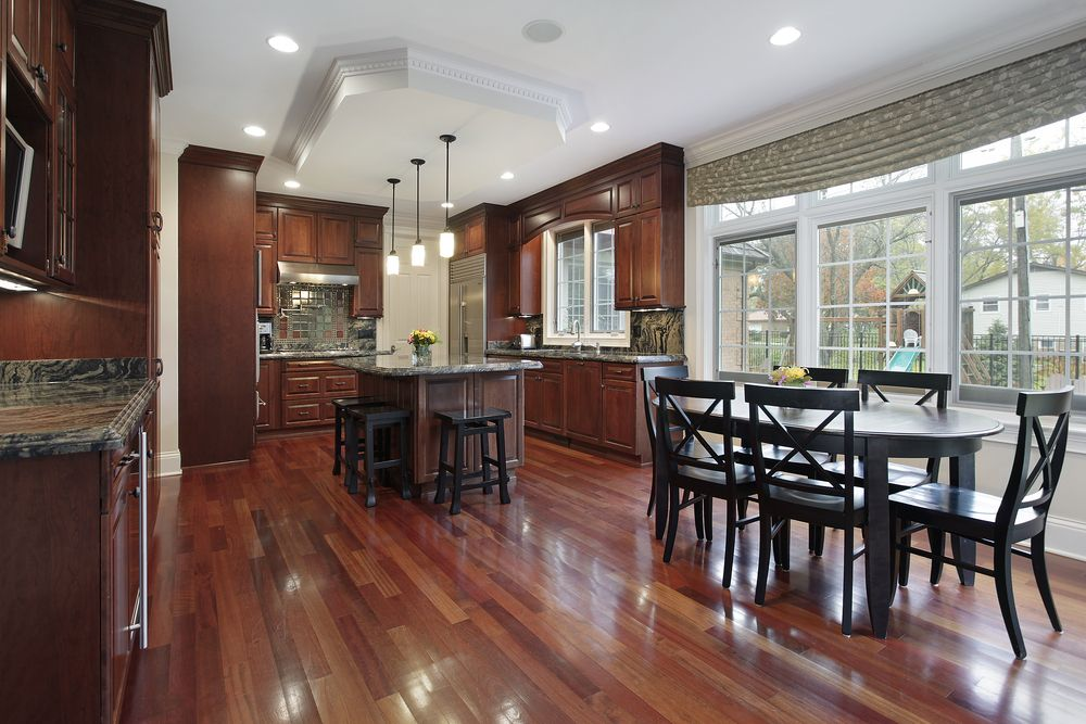 Red Hardwood Floors And Cabinets Tie This Kitchen Together