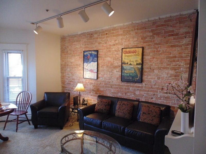 Rustic Living Room with Exposed brick Carpet