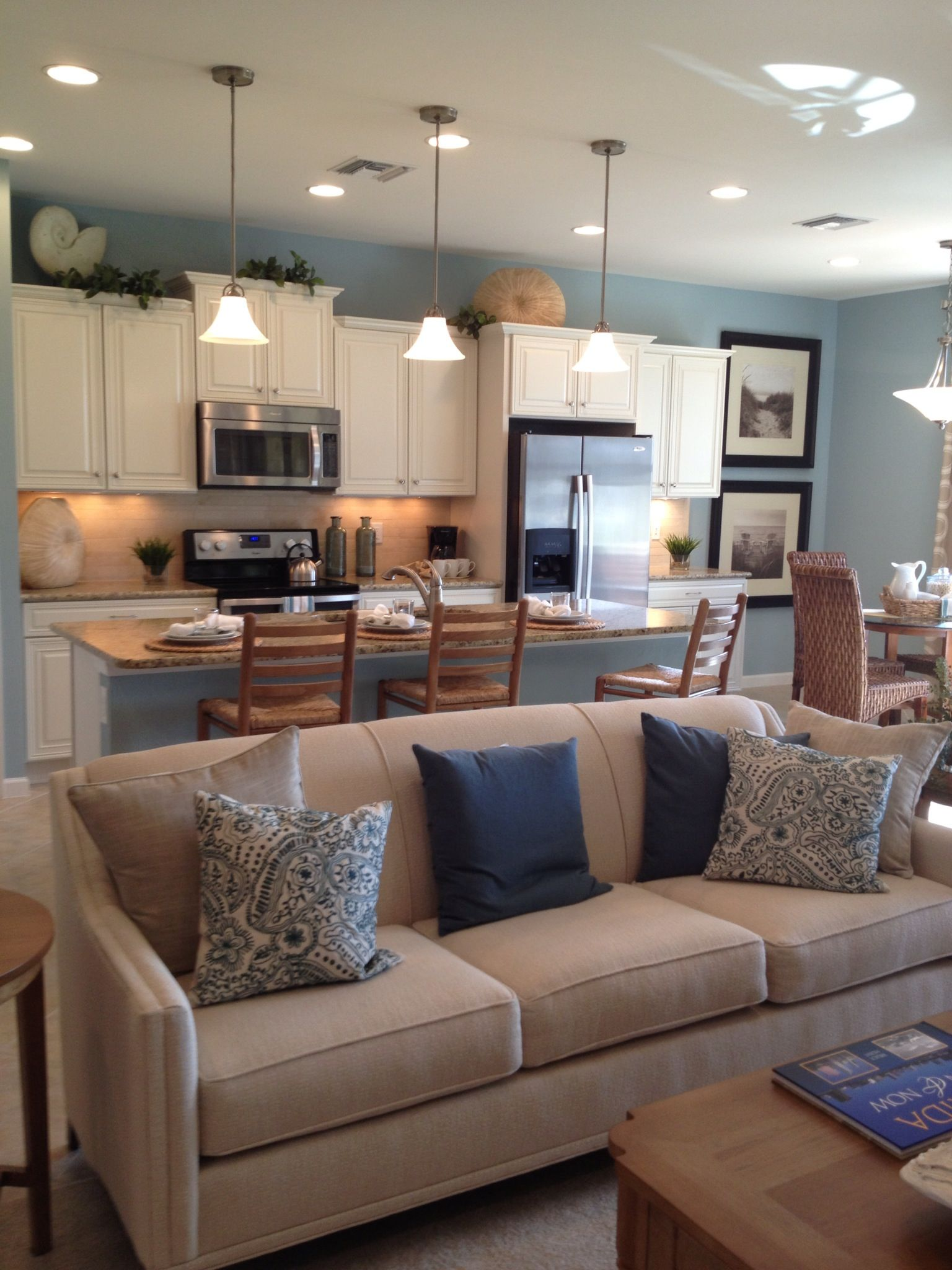 Kitchen Living Room >> Open kitchen/living area. Like the neutral countertops and backsplash, the straw dining chairs