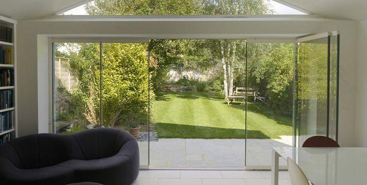 Frameless Glass Sliding Doors Bringing The Garden Inside