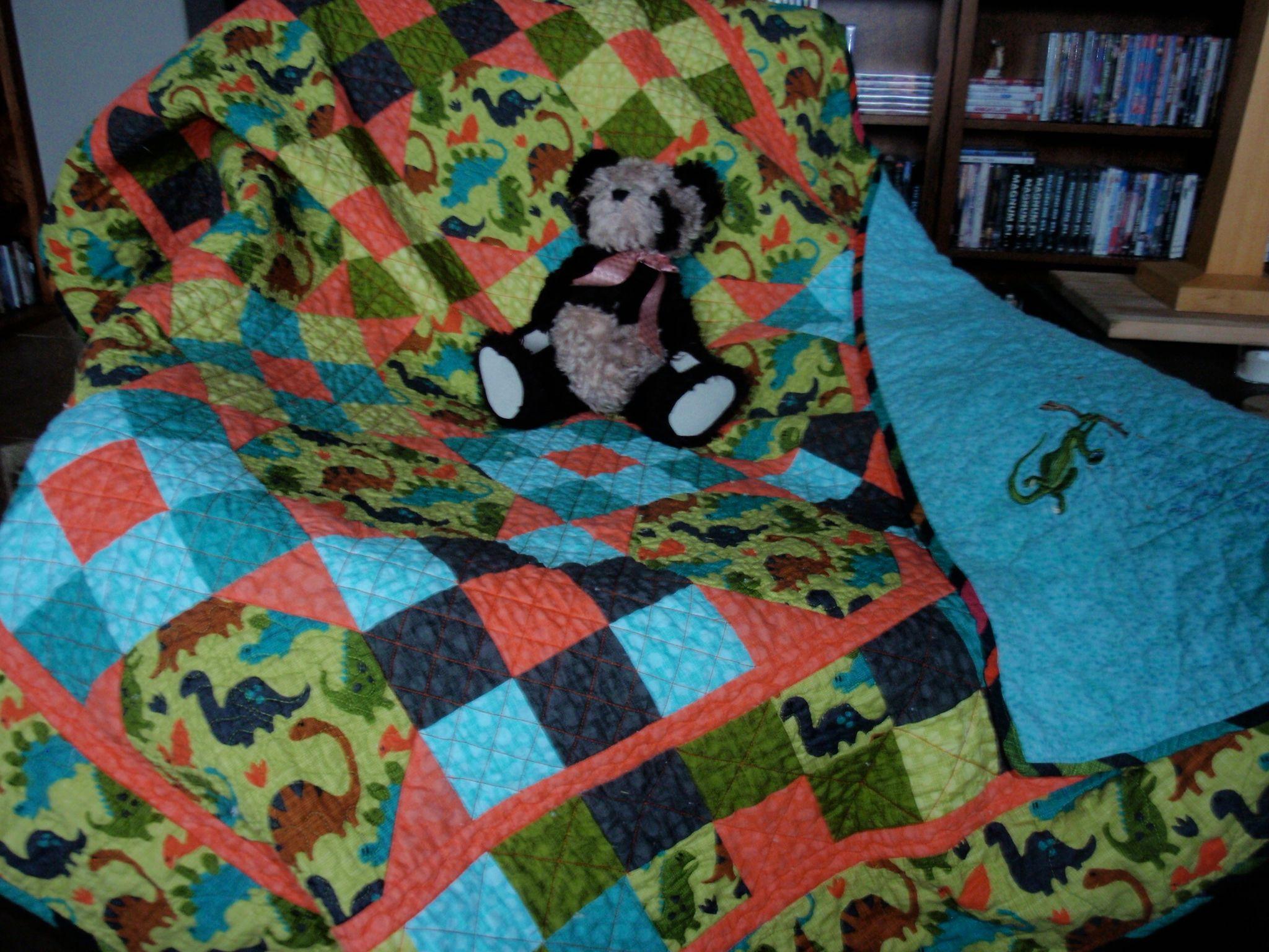 By kbassi - Dinosaur quilt done in Delaware blocks; flannel back.