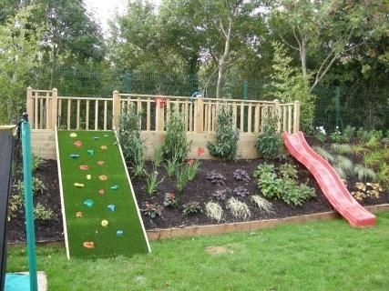 Awesome Idea Slide Deck And Rock Wall Built On Yard Slope I D Love To Do This At Our House Pinmydreamback Kid Friendly Backyard Backyard Backyard Play