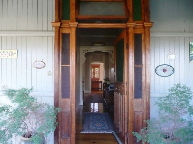 Front door surround in natural timber colour for Front door queenslander