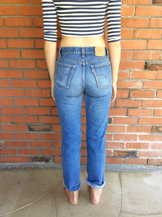 3b3a8a89 Vintage Levis 701 button fly shrink to fit high waist denim jeans. The 701  style is the slim fit version of the classic 501 style. It runs slimmer