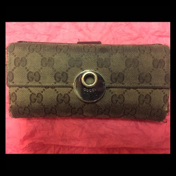 Authentic Gucci wallet!!! Authentic Gucci monogram wallet. A lot of wear which explains the low price but it's still Gucci! Willing to bundle with the matching bag. Gucci Bags Wallets