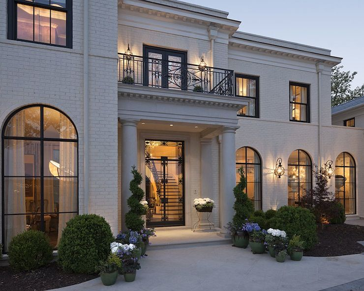 Exquisite Home Designers. House Stunning home featuring white brick exterior accented with arched