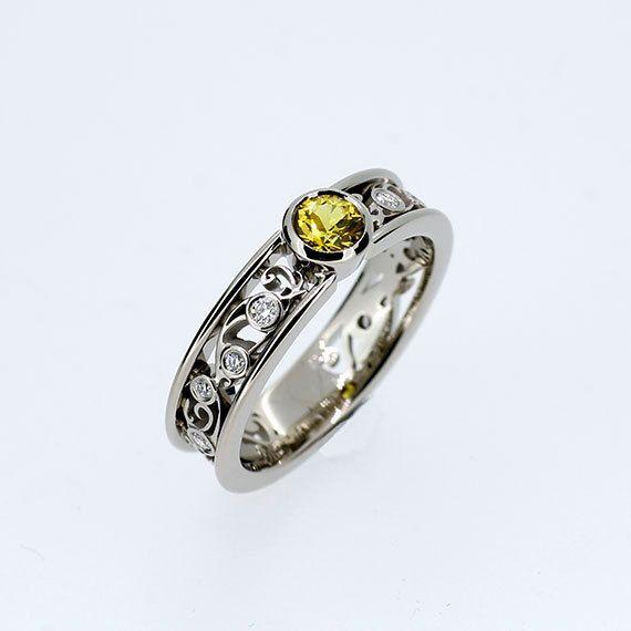 Yellow sapphire and diamond bezel filigree ring by TorkkeliJewellery