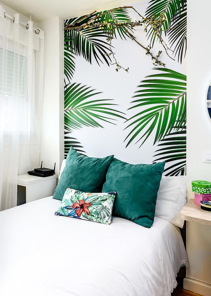 Allwhite bedroom with a tropical wallpaper headboard