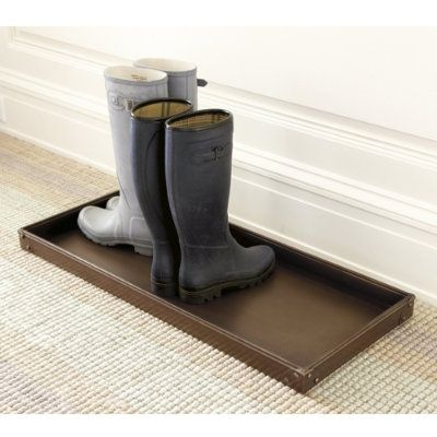 Boot Tray from Ballard Designs. Mine has a beautiful diamond quilt pattern. The best for rain, snow and mud covered shoes and boots.