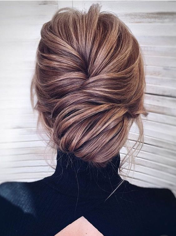 A Chic And Refined Voluminous Low Bun With A Bump And Some Locks Down For Pure Elegance Long Hair Styles Hair Styles Bridal Hair