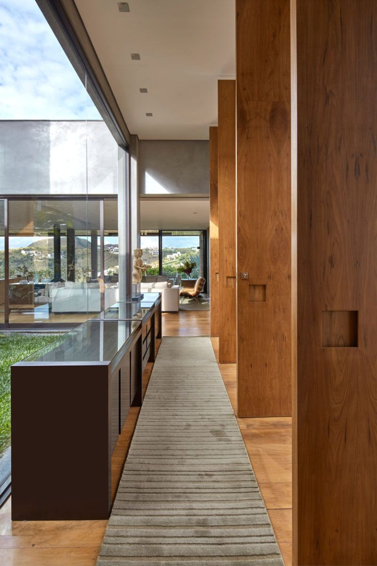 Stepping inside this modern house large windows surround an internal garden while  hallway leads to the main living areas of home also david guerra designs in brazil for family that enjoys rh pinterest