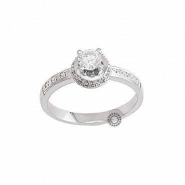 Ένα εντυπωσιακό μονόπετρο δαχτυλίδι από λευκόχρυσο Κ14 με ζιργκόν  περιμετρικά του μονοπέτρου και με πλαϊνά σειρέ 5d4057e8ea9