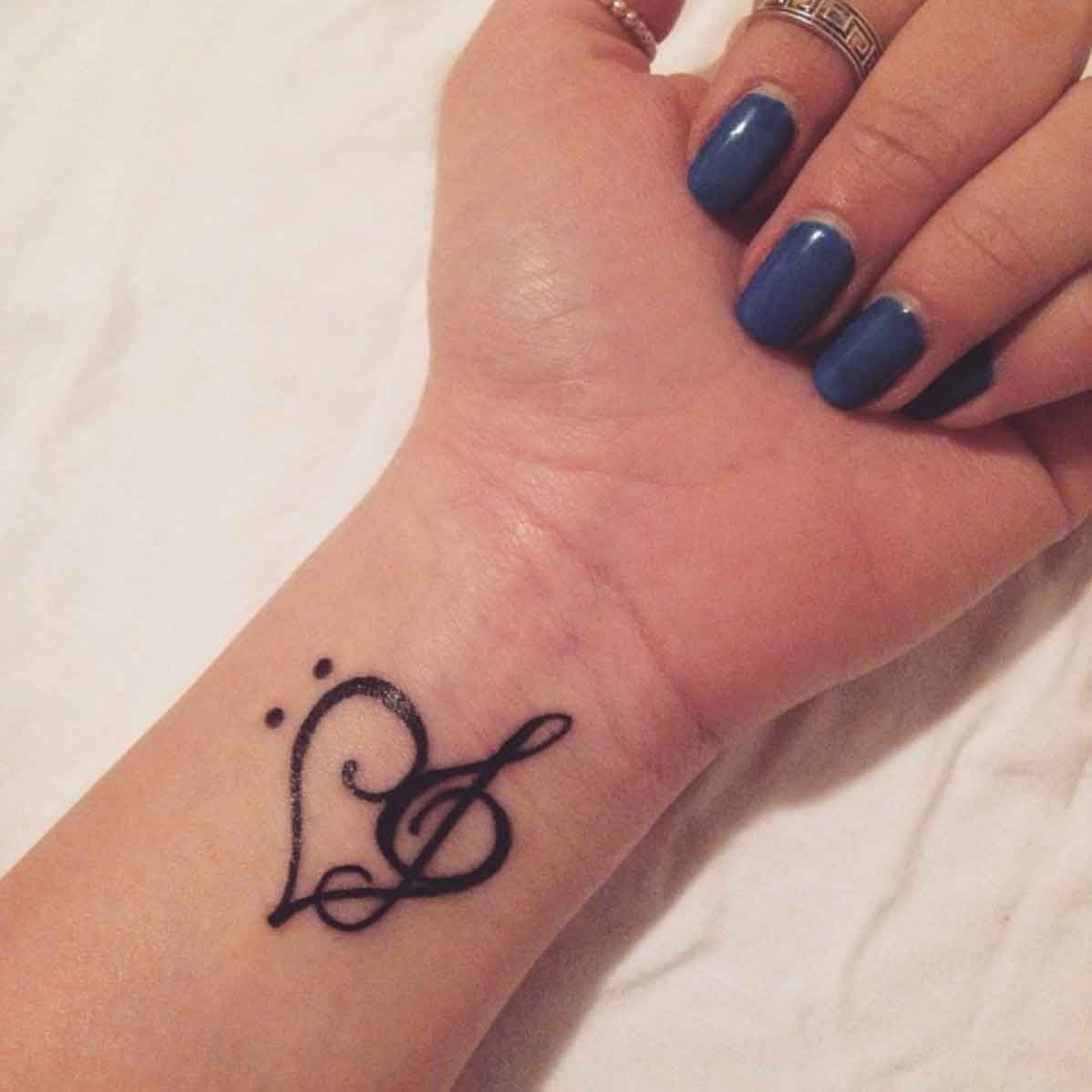 little wrist tattoo of a bass clef and a treble clef creating a rh pinterest com treble clef heart tattoo meaning treble clef love heart tattoo
