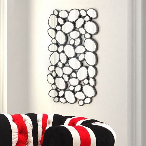 """Small pebble shaped mirror pieces are set in raised frame for a bold look for the Treble mirror. Hang vertical or horizontal for a look for modern look to any room or design. Size: 30"""" w x 51"""" h"""