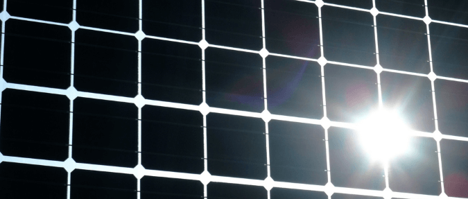 A reflection (glare/ dazzle) off of a photovoltaic solar panel -  We provide Glint and Glare Assessments
