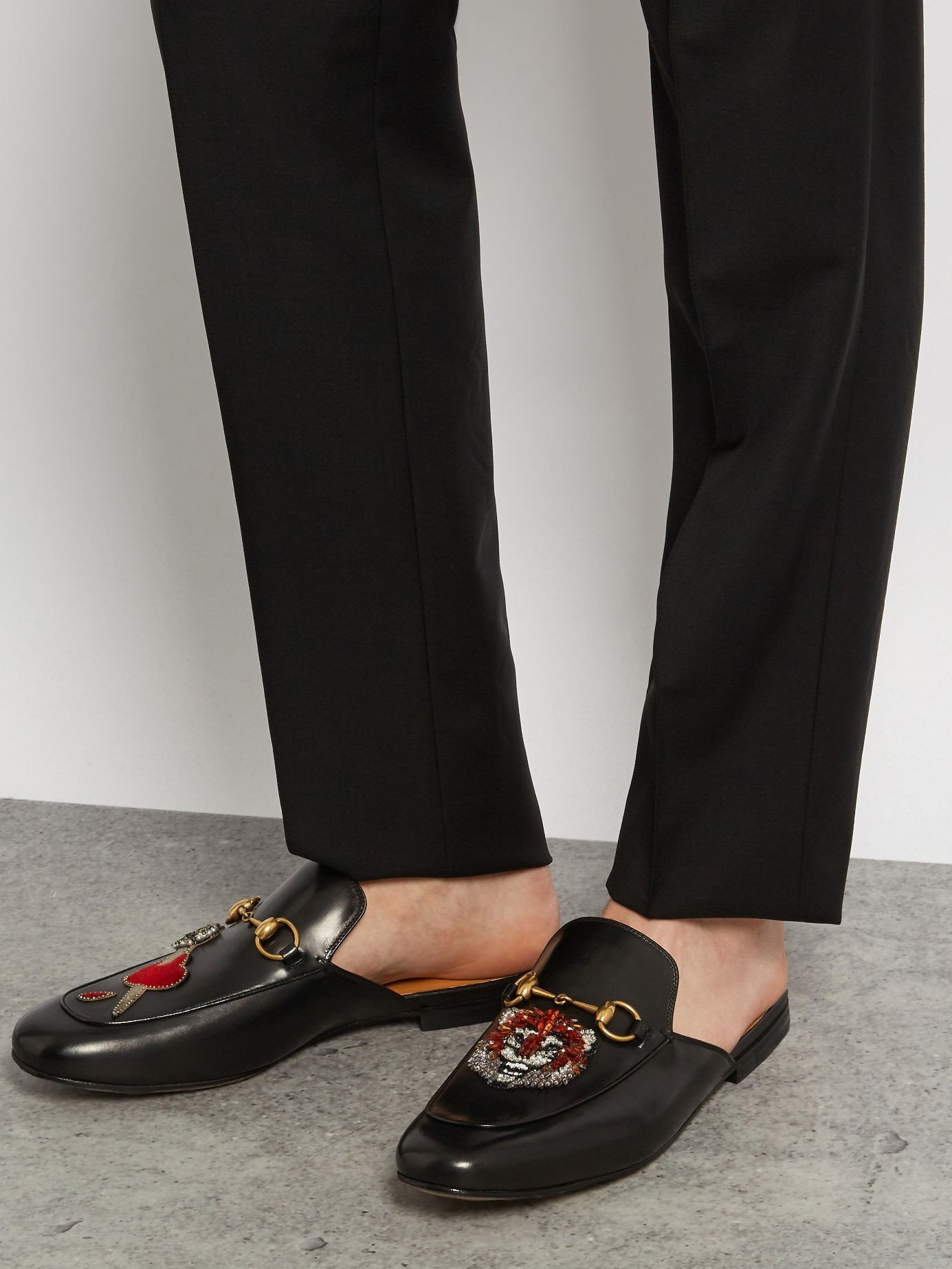 19e40ec25 Click here to buy Gucci Sword and tiger-embellished backless loafers at  MATCHESFASHION.COM