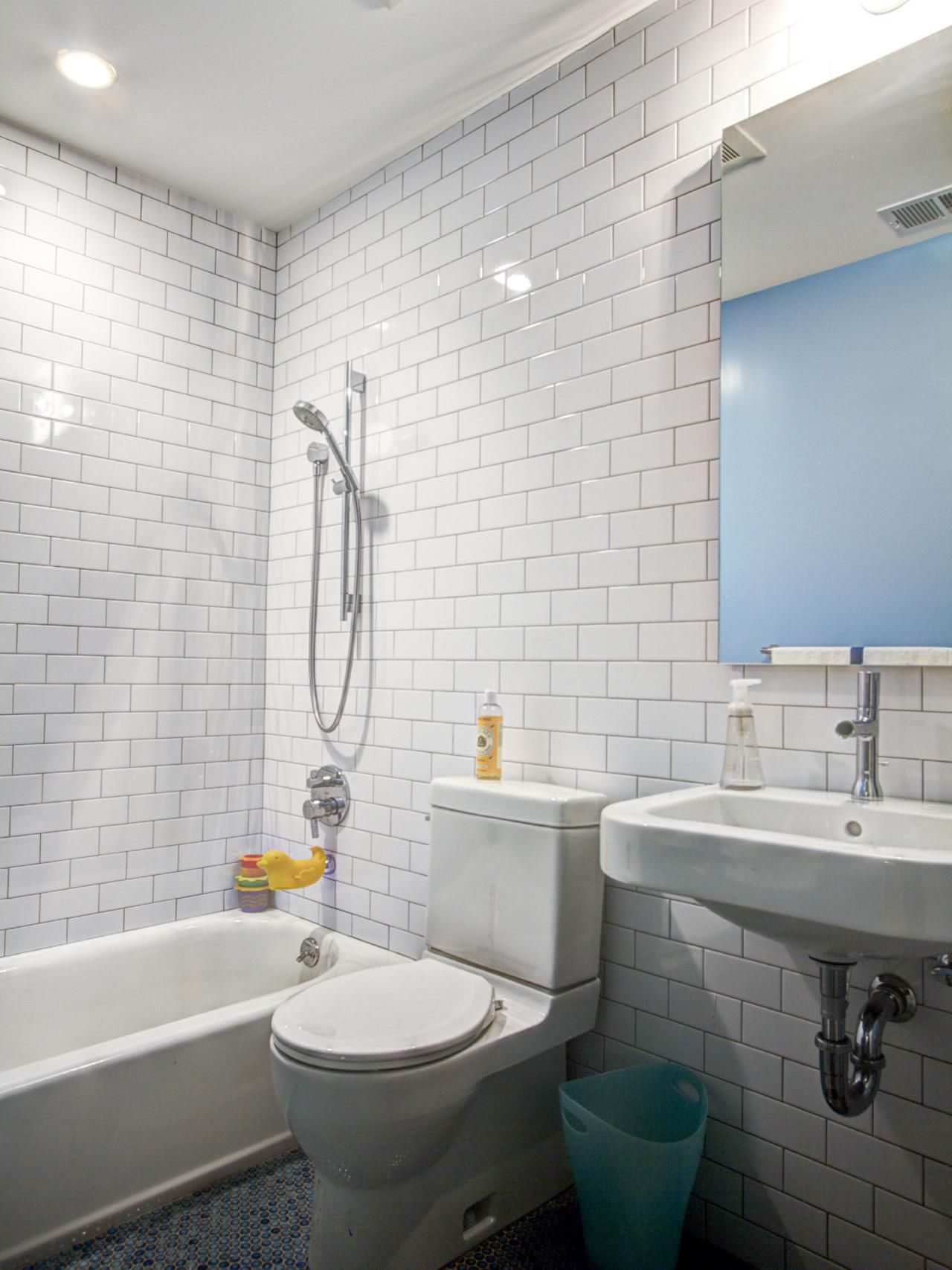 White subway tile plays well against the dark charcoal mosaic tile ...
