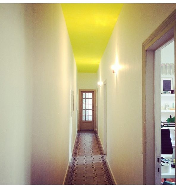 Yellow painted ceiling hallway..... Maybe not yellow for me.. But ...