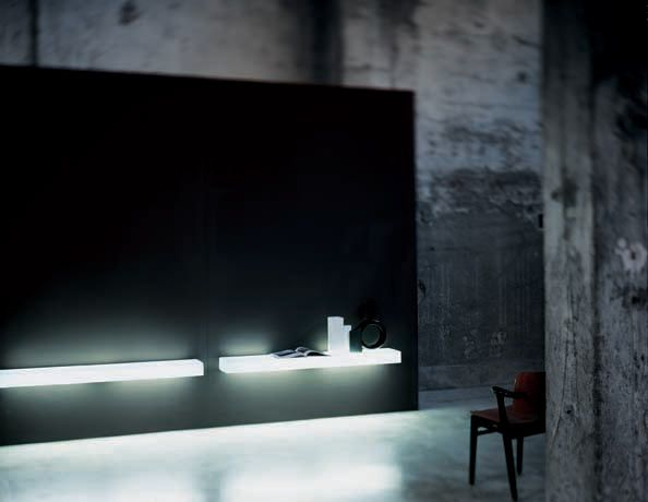 Light-Light.  Collection of wall-mounted shelves composed of opaque white, tempered glass plates with chamfered edge.