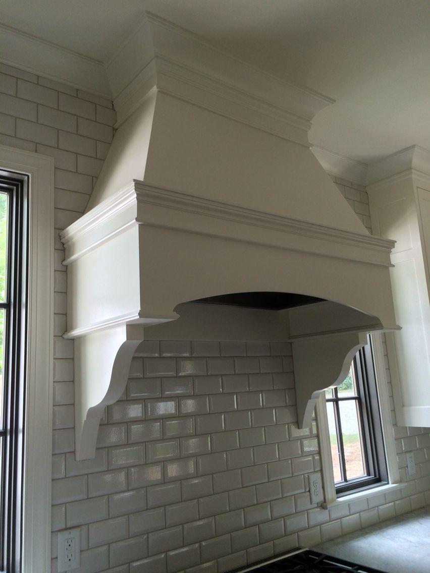 Custom hood in white dove by Benjamin Moore .Walker Zanger beveled crackle backsplash. Meg White Interiors