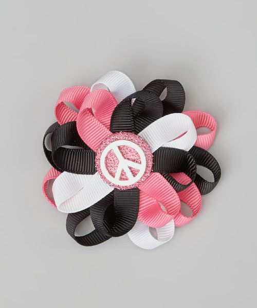 For special dress-up occasions or any day that needs a splash of fun and color, this bright bow with its glimmering center will add the perfect amount of panache to any hairdo.NylonSpot cleanMade in the USA