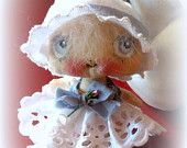 Tiny baby cloth doll in Antique eyelet